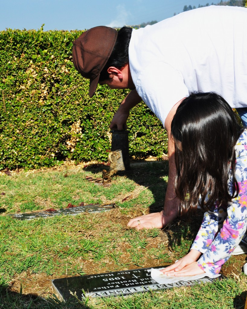 del and kai cleaning the grave