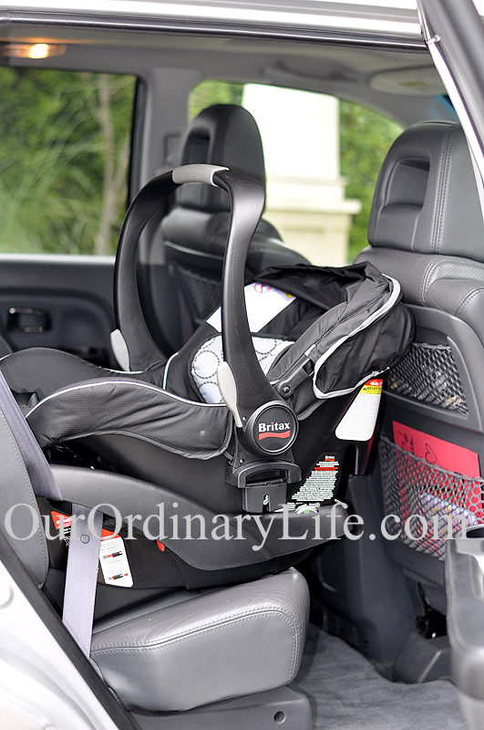 Britax B-Agile in car with grey leather interior