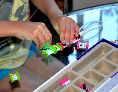 kid playing with littlebits circuits