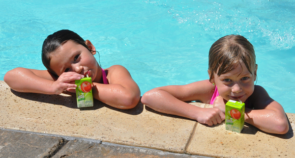 kids in pool juicy juice swimming cool off