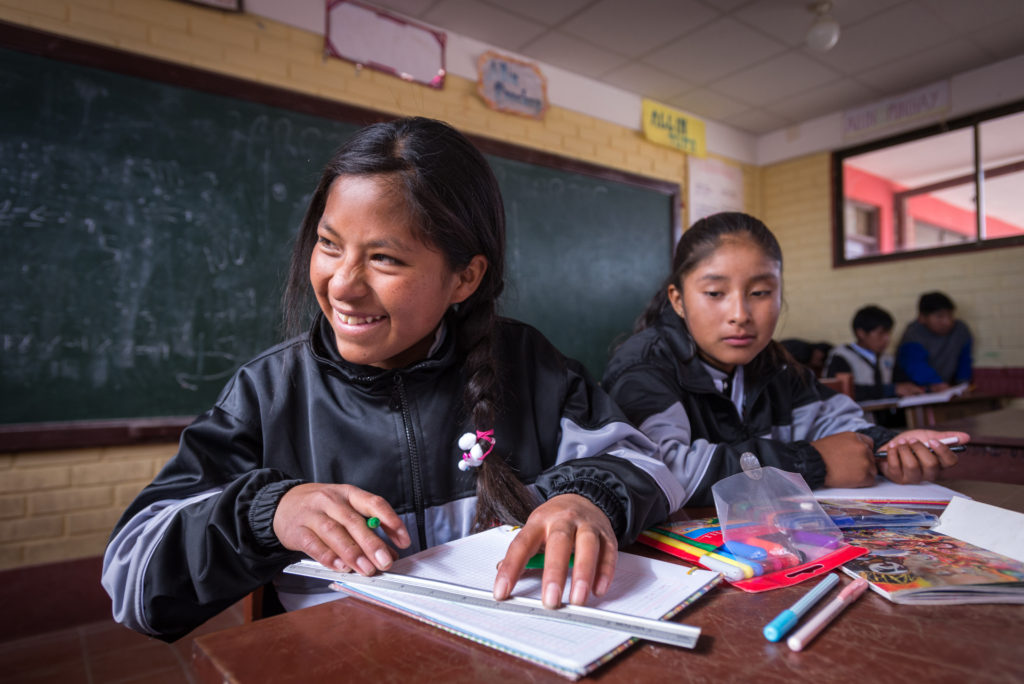 """See full story: Share# s150466-1 -- Sponsored child Yuridia Alejandra Mamani Pomo, 13, sits at her desk in Oruro, Bolivia. """"I'm in seventh grade and my favorite subjects are mathematics and physics and music,"""" Yuridia says.Her father Lucio Mamani Katari is a farmer in Soracachi ADP who is breaking ground in his community. Sponsorship enables his generosity and strengthens his commitment to his daughter's future. Despite the area's high poverty rate, Lucio makes ends meet for his family of eight thanks to sponsorship-funded agriculture training. In fact, he gives away his best produce to others. Lucio also began to see the value of education for his children through sponsorship. He went against cultural norms and encouraged his 13-year-old daughter, Yuridia, a sponsored child, to pursue more school.  Since his community does not have a high school, Lucio sent Yuridia to live with an aunt in another city to continue her education. This decision likely decreased the chance of early marriage for his daughter."""