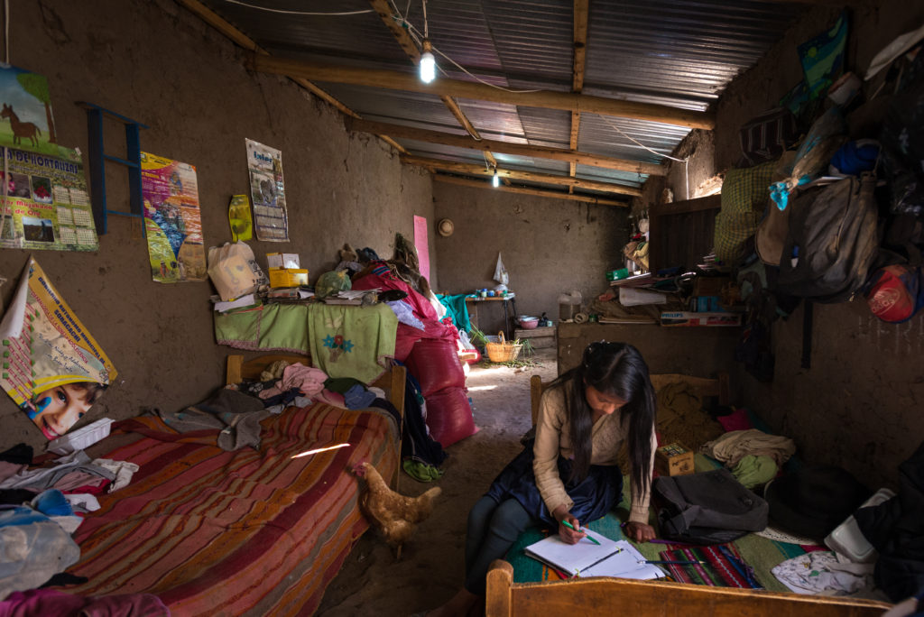 "See full story: Share# s150466-1 -- Sponsored child Yuridia Alejandra Mamani Pomo, 13, does her homework at her home in Soracachi, Bolivia.  ""I'm in seventh grade and my favorite subjects are mathematics and physics and music,"" Yuridia says.  Her father Lucio Mamani Katari is a farmer in Soracachi ADP who is breaking ground in his community. Sponsorship enables his generosity and strengthens his commitment to his daughter's future.  Despite the area's high poverty rate, Lucio makes ends meet for his family of eight thanks to sponsorship-funded agriculture training.  In fact, he gives away his best produce to others. Lucio also began to see the value of education for his children through sponsorship.  He went against cultural norms and encouraged his 13-year-old daughter, Yuridia, a sponsored child, to pursue more school.  Since his community does not have a high school, Lucio sent Yuridia to live with an aunt in another city to continue her education.  This decision likely decreased the chance of early marriage for his daughter."