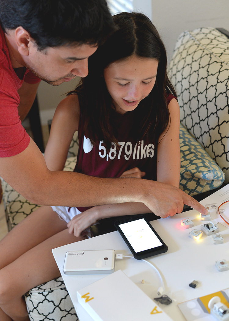 Dad Creating Wireless Circuits With daughter