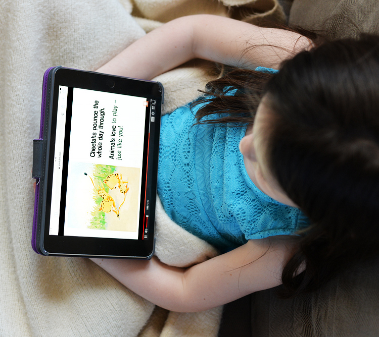 reading story teller on ipad toddler