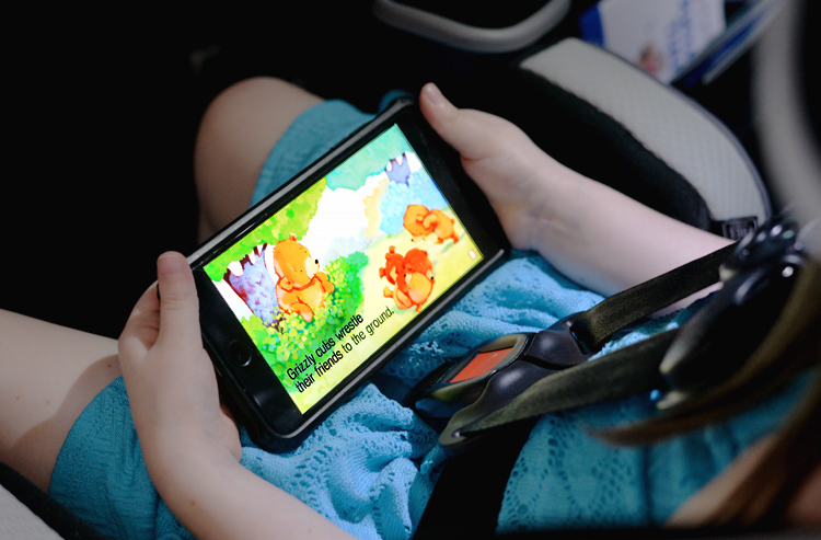 story teller in the car on the go road trip toddler