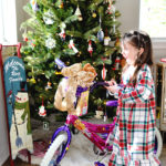 little girl excited by new bike barbie
