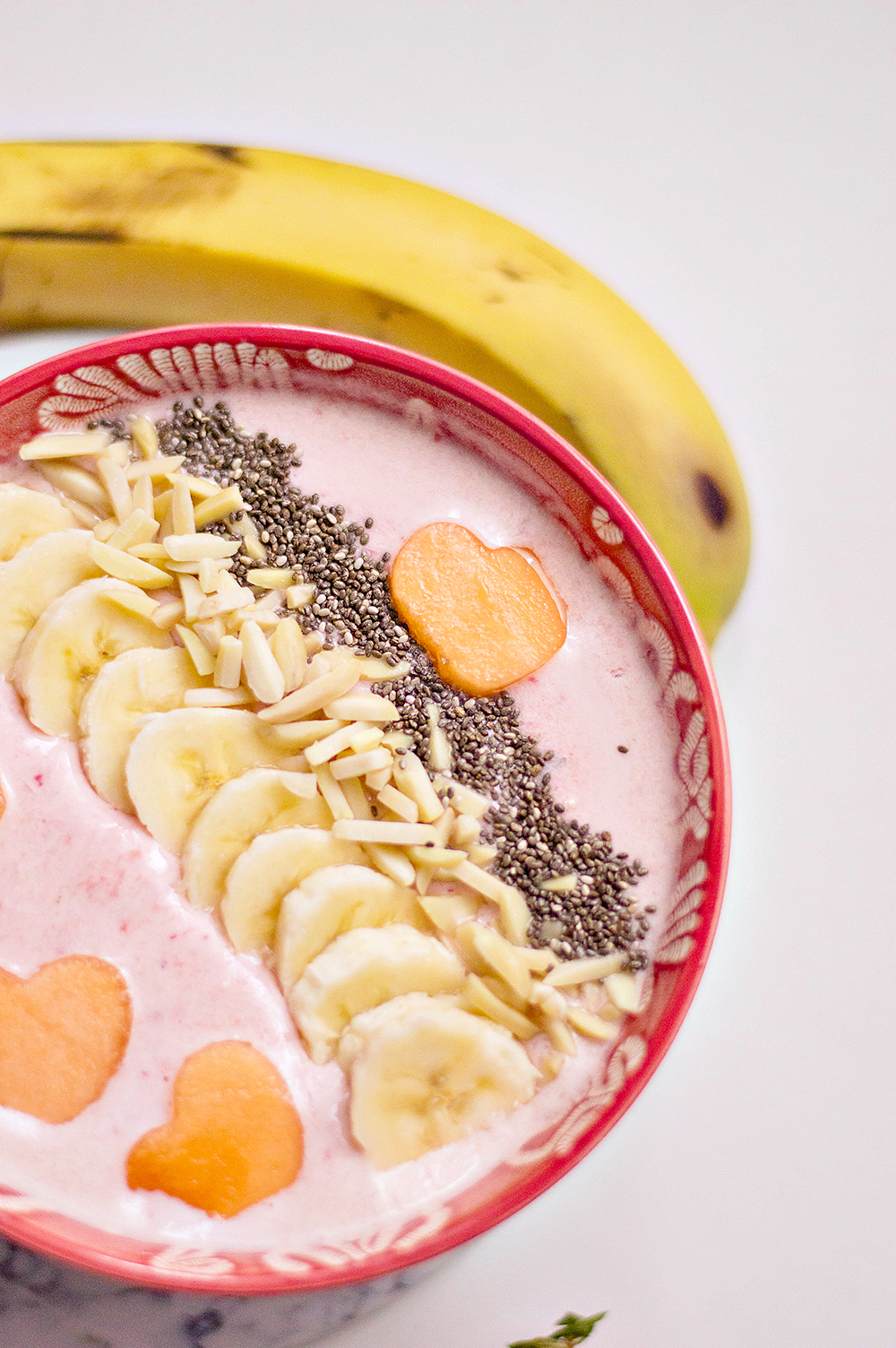 Using your cookie cutter, cut out hearts from your cantaloupe. Place carefully on top of your smoothie bowl.